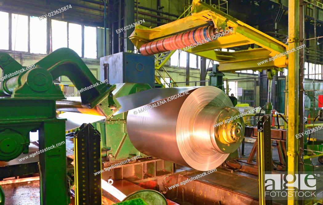 Stock Photo: Zinc coils of stell in steel plant.