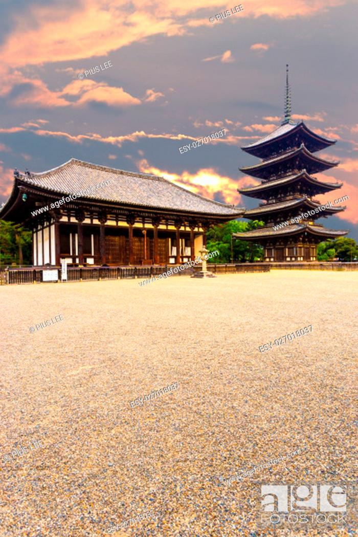 Stock Photo: The front of the East Golden Hall, To-kondo, and five story pagoda, Goju-no-to, in Kofuku-ji Buddhist temple on beautiful sunset evening in Nara, Japan.