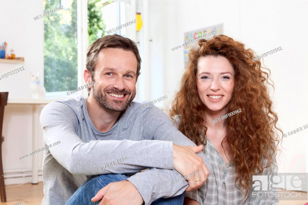 Stock Photo: Germany, Berlin, Couple smiling, portrait.