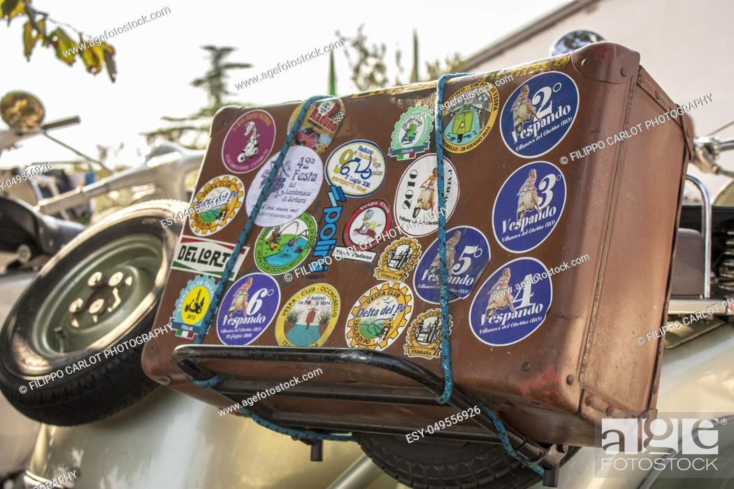 Stock Photo: vintage suitcase tied on the luggage rack of a Vespa history. The emblem of Italian traditions. An old way of traveling.
