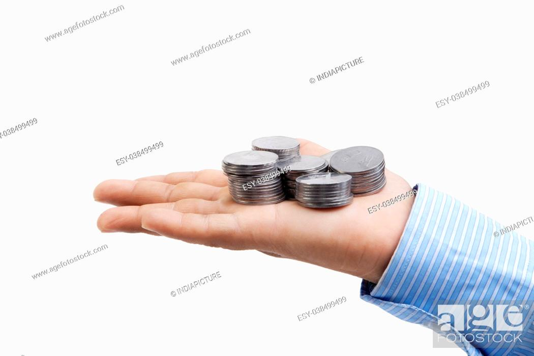 Stock Photo: Hands with coins isolated on white background.