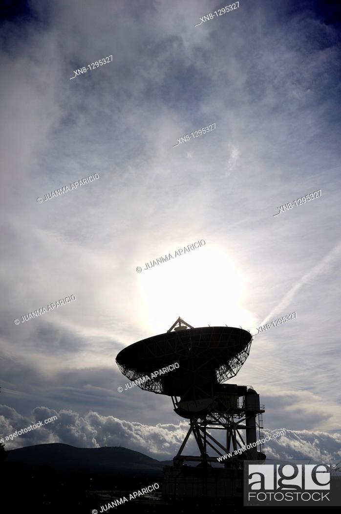 Stock Photo: Communications satellite dish photographed backlit.