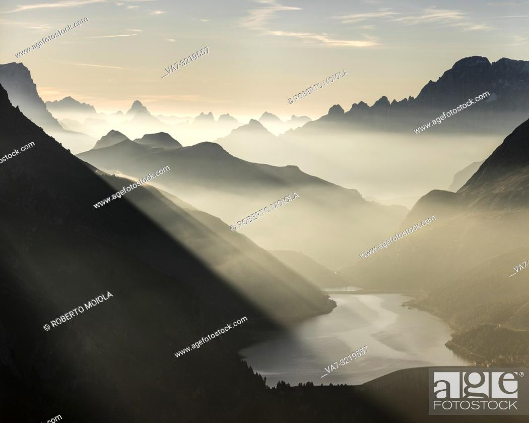 Imagen: Panorama of Fedaia Pass and Dolomites peaks shrouded by mist Cima Belvedere Val di Fassa Trentino Alto Adige Italy Europe.