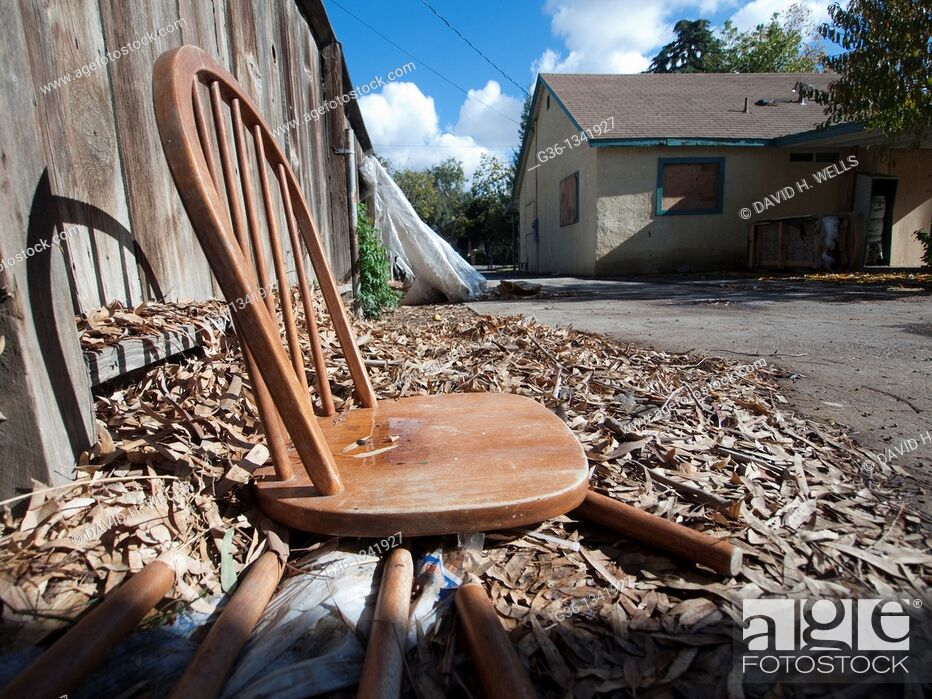Stock Photo: A collapsed chair in the backyard of a foreclosed house in Fresno, California, United states.