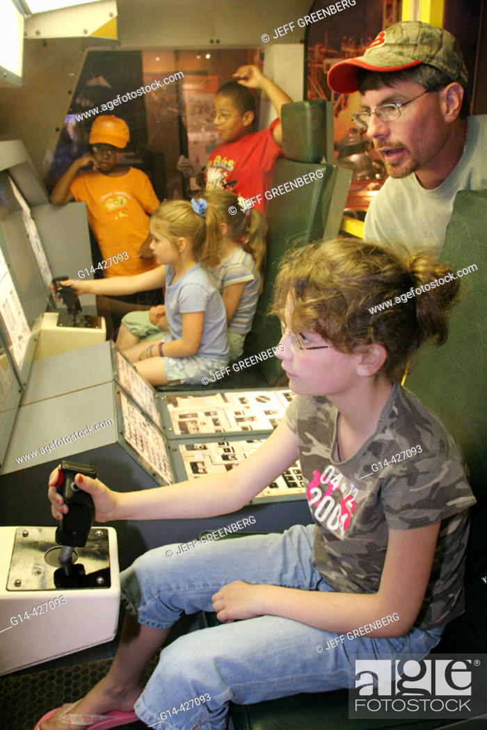 Shuttle flight simulator, father, daughter  U S  Space and