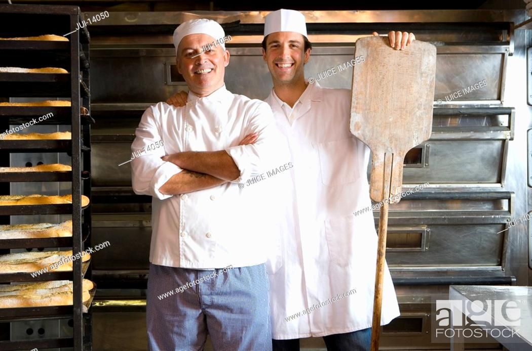 Stock Photo: Baker with arms crossed, colleagues hand on shoulder, smiling, portrait.