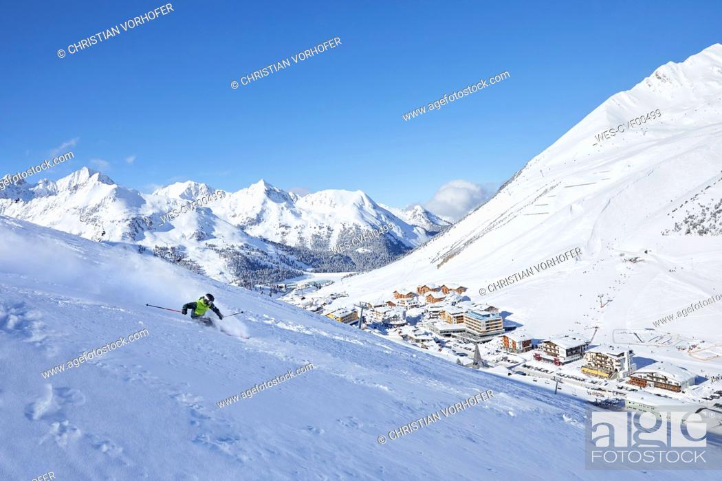Stock Photo: Austria, Tyrol, Kuehtai, man skiing in winter landscape.