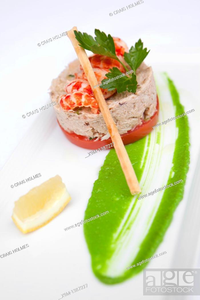 Stock Photo: Starter of fish pate with crayfish tails, lemon wedge and breadstick.