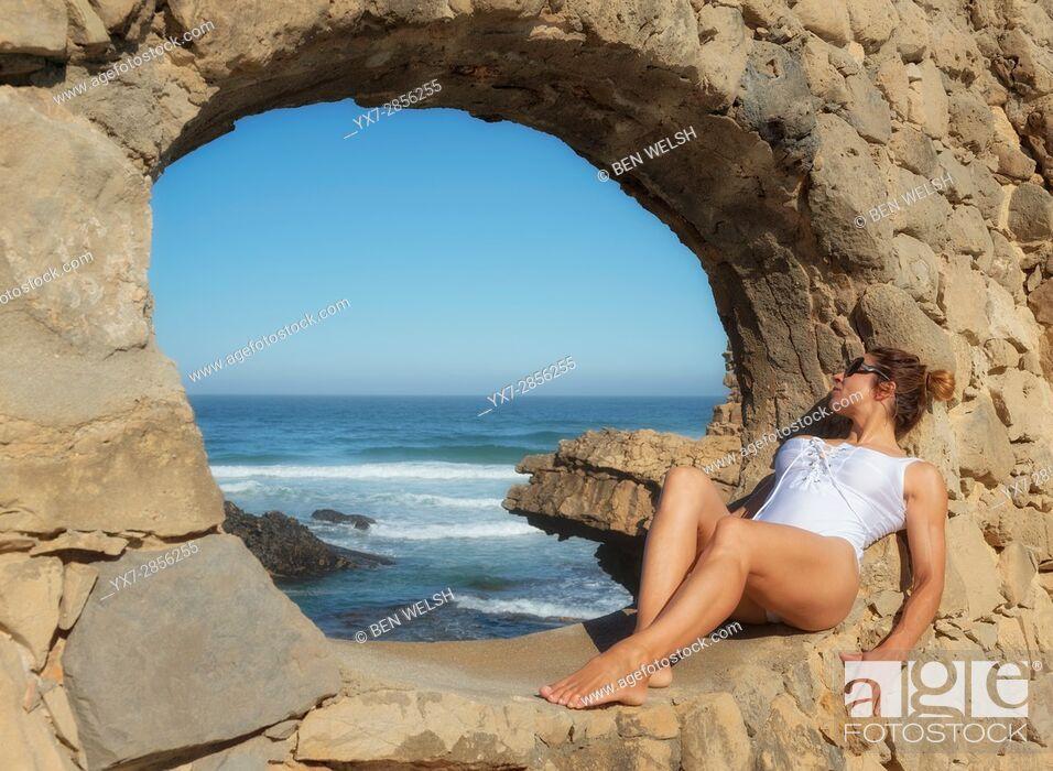Stock Photo: Woman sunbathing at the Muchaxo Hotel, Praia do Guincho, Portugal.
