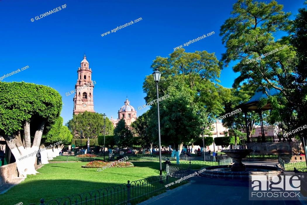 Stock Photo: Park with a cathedral in the background, Morelia Cathedral, Plaza De Los Martires, Morelia, Michoacan State, Mexico.
