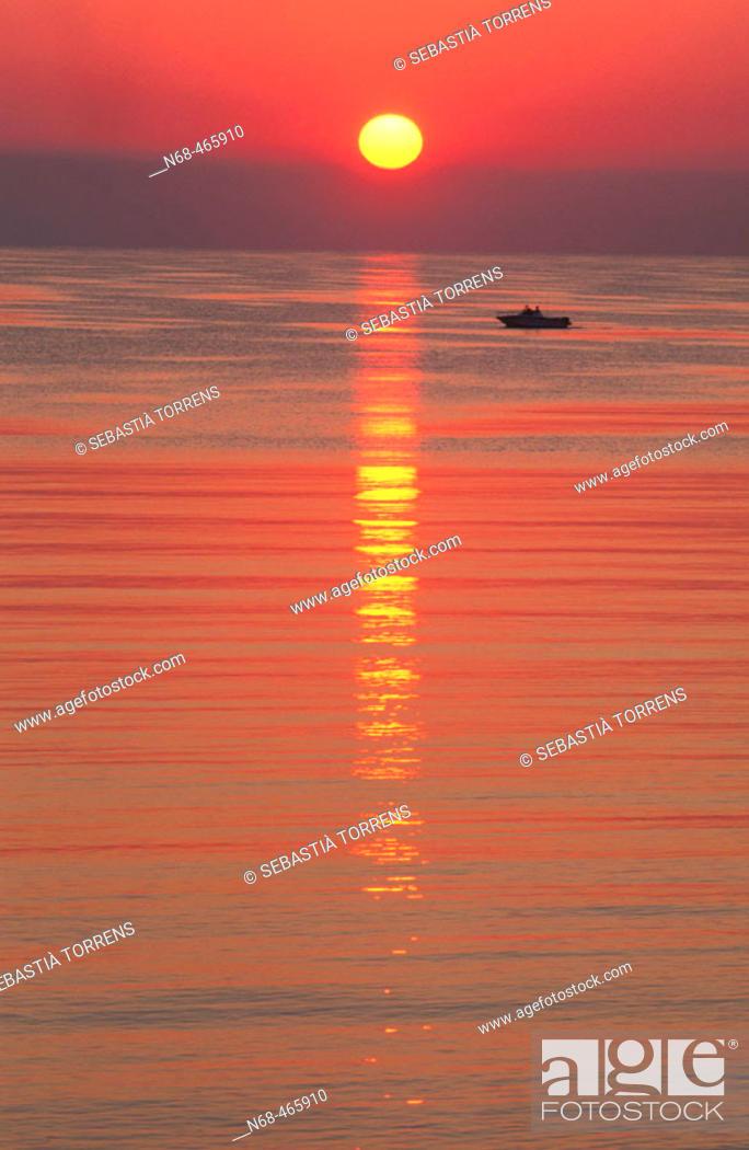 Stock Photo: Boat at sunrise.