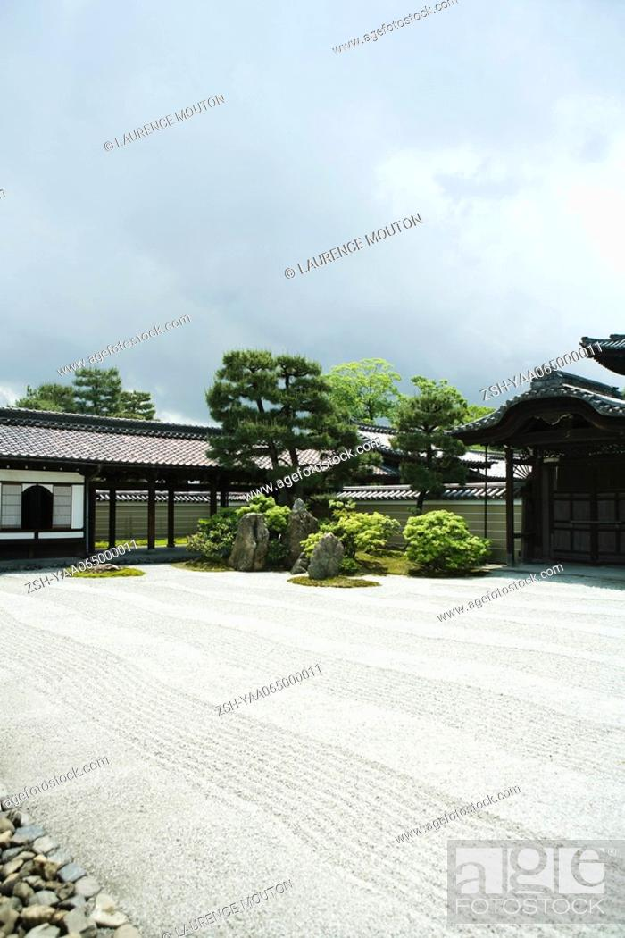 Stock Photo: Japanese rock garden and temple.