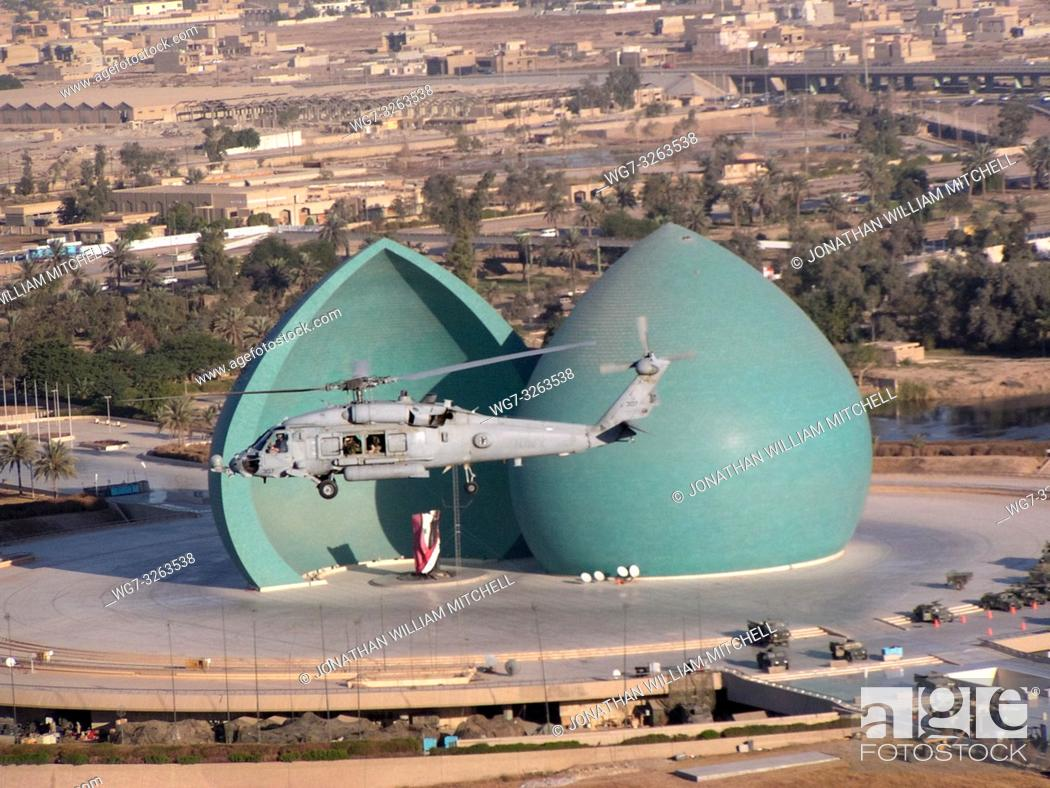 Stock Photo: IRAQ Baghdad -- 30 Nov 2003 -- A helicopter assigned to the â. œFirehawksâ. . of Helicopter Combat Search and Rescue Squadron Five (HCS-5) flies over the.