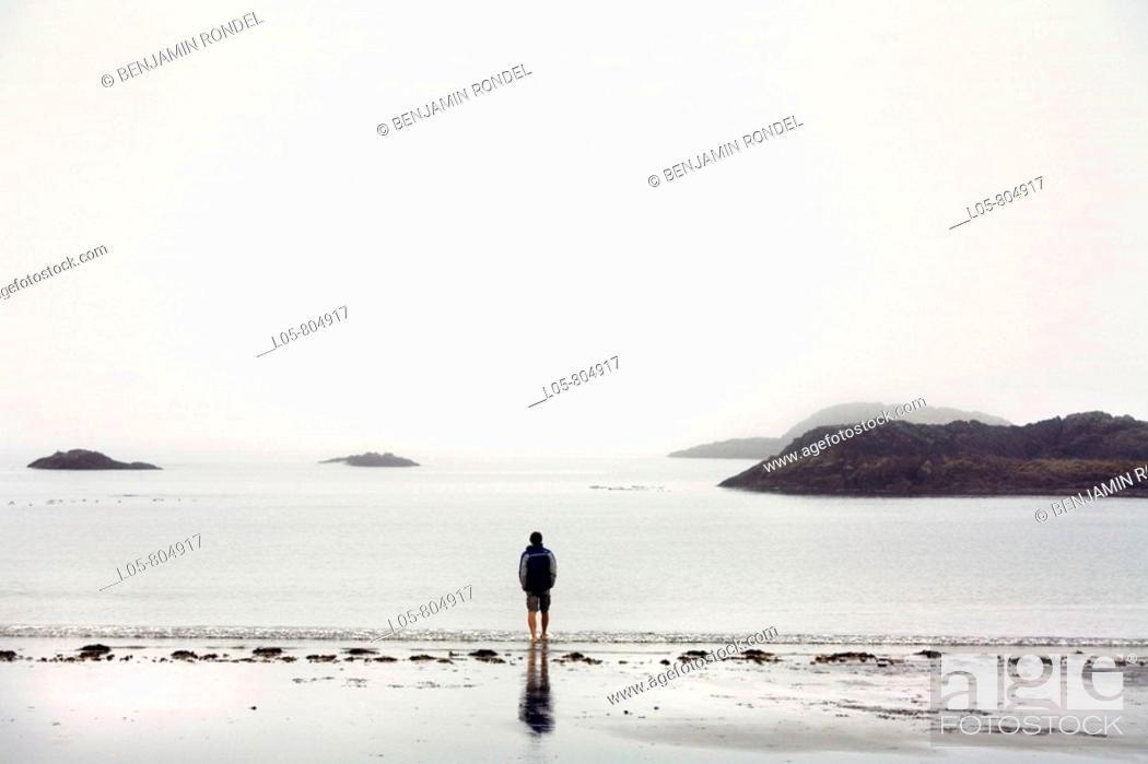 Stock Photo: A man looking at the Pacific Ocean at Tofino, Vancouver Island, British Columbia, Canada.