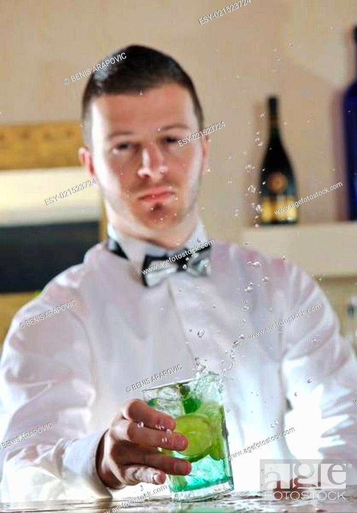 Stock Photo: pro barman prepare coctail drink on party.