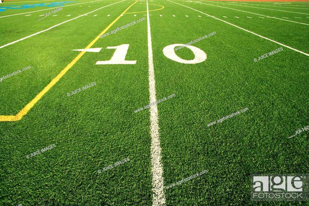 Stock Photo: Close up of the 10 yard line in football field.