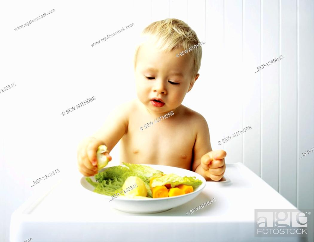 Stock Photo: Little boy eating.