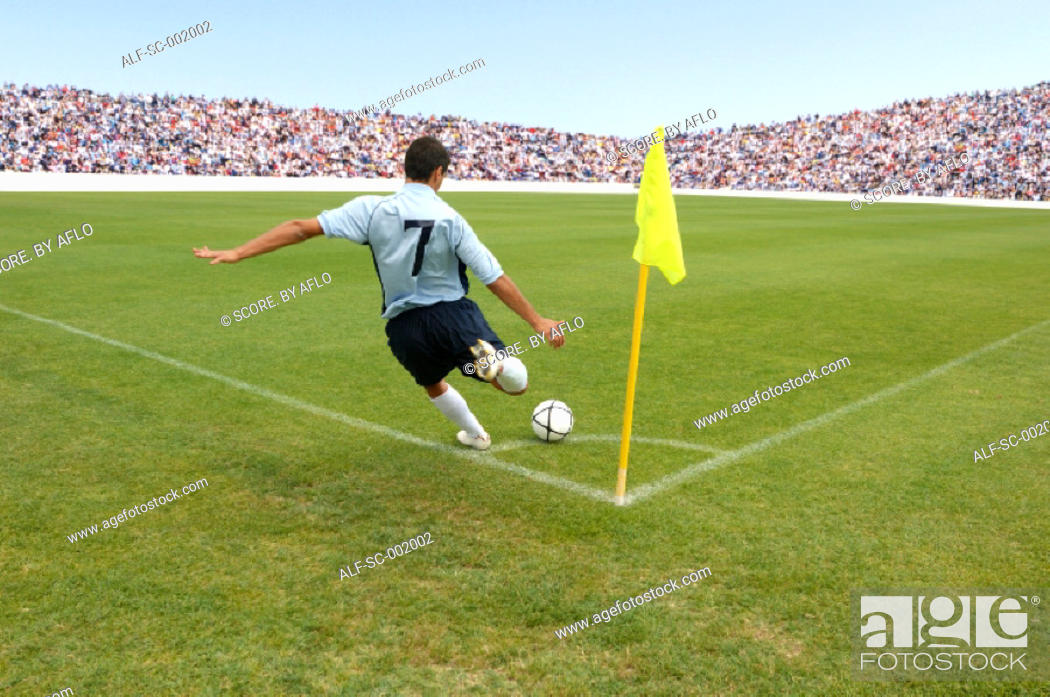 Stock Photo: Soccer player taking corner kick.