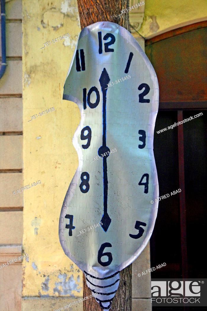 Stock Photo: Dalinian clock, street decoration, Festes de Sants 2019, Barcelona, ??Catalonia, Spain.