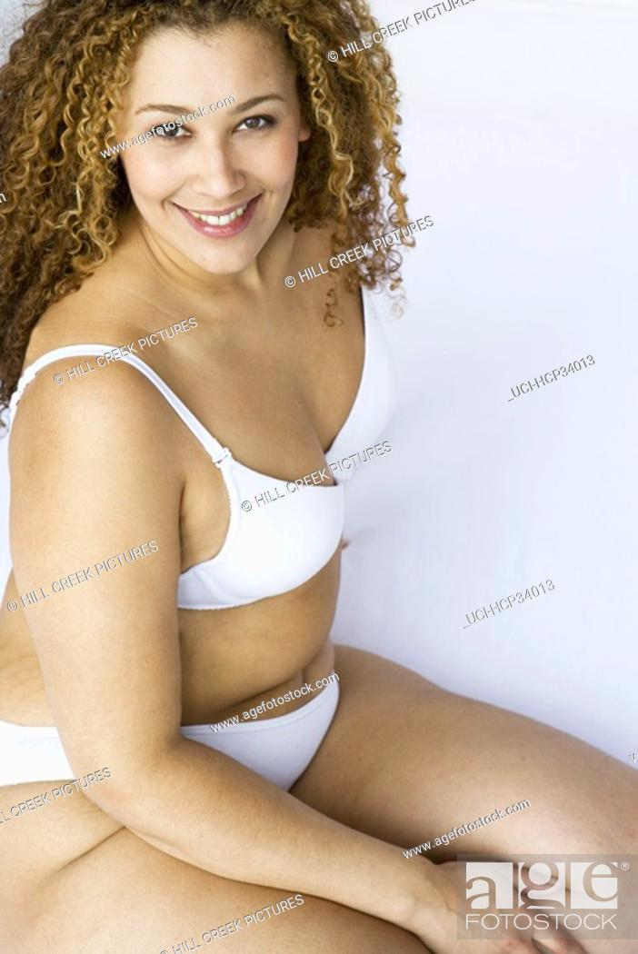 Stock Photo: High angle view of woman wearing bra and panties.