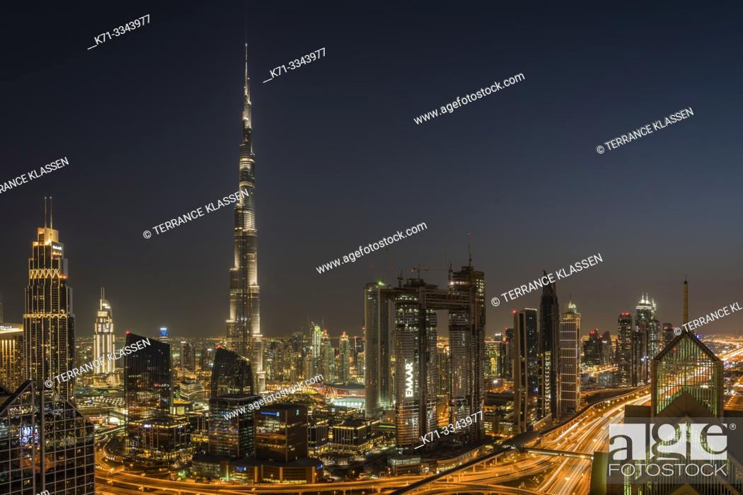 Stock Photo: The Burj Khalifa and city skyline at night in downtown Dubai, UAE, Middle East.