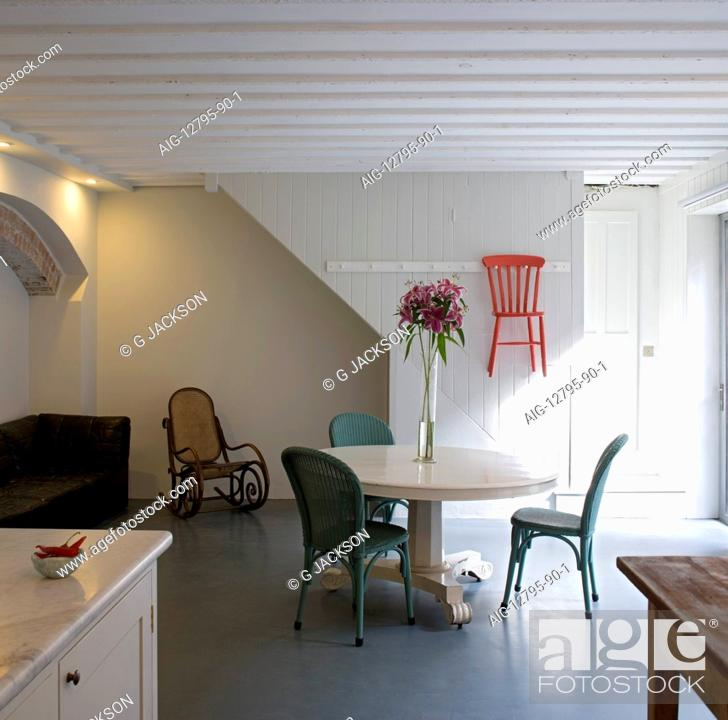 Stock Photo Kitchen Dining Room With White Painted Pedestal Table And Shaker Style Hanging Chair