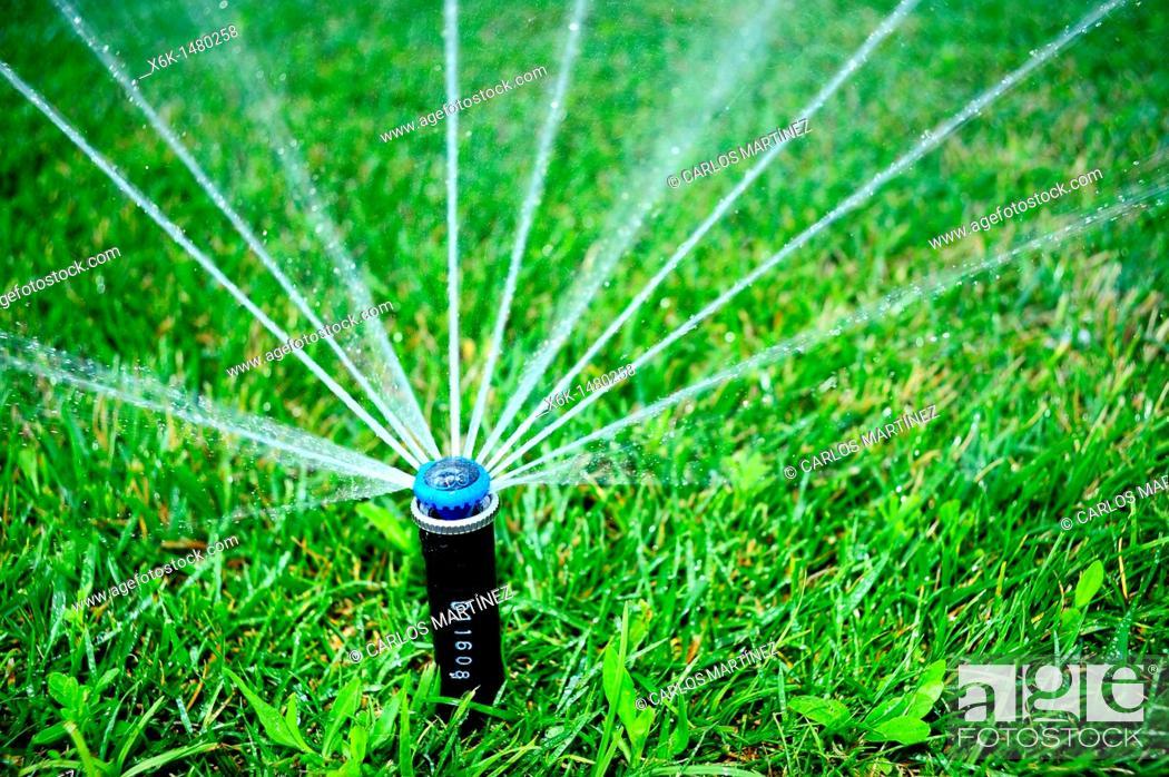 Stock Photo: Sprinkler, Barcelona, Catalonia, Spain.