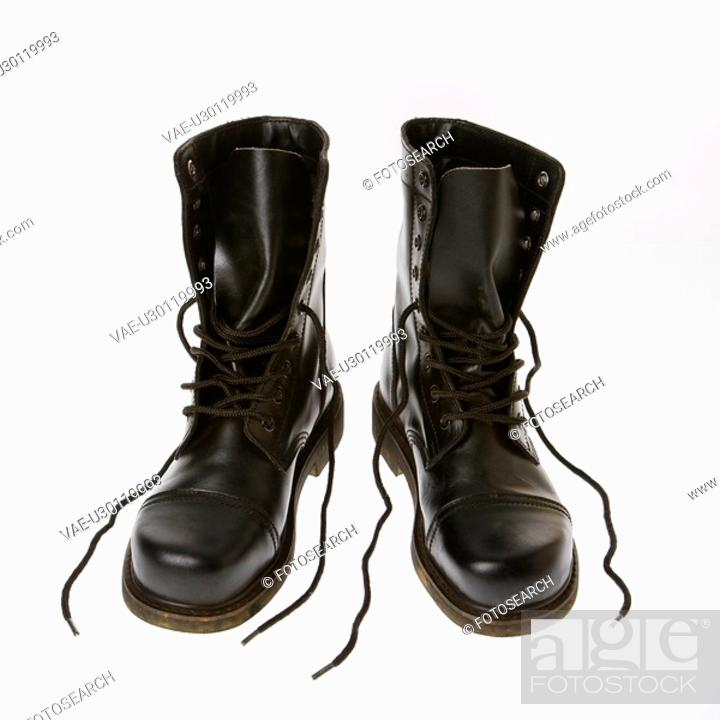 Stock Photo: Black leather boots with laces untied.