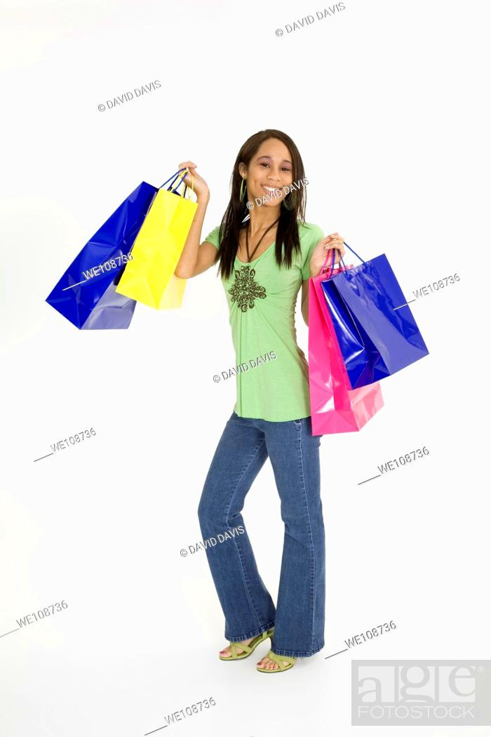 Stock Photo: Young African American woman shopping.