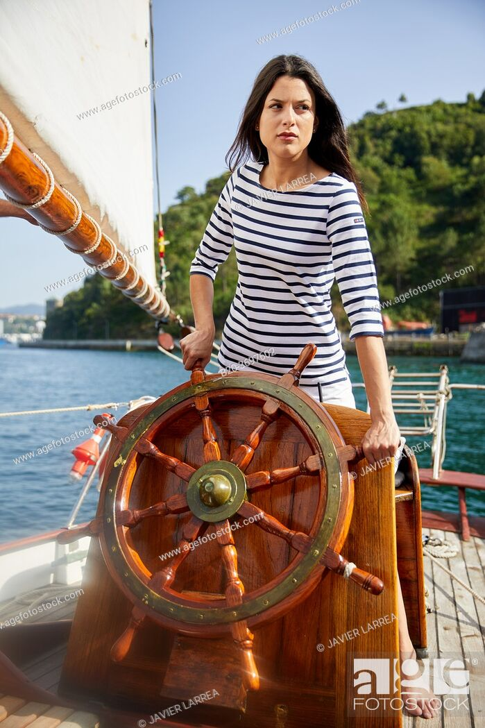 Stock Photo: Young woman with sailor clothes, Helm, Sailboat, Pasaia, Gipuzkoa, Basque Country, Spain, Europe.