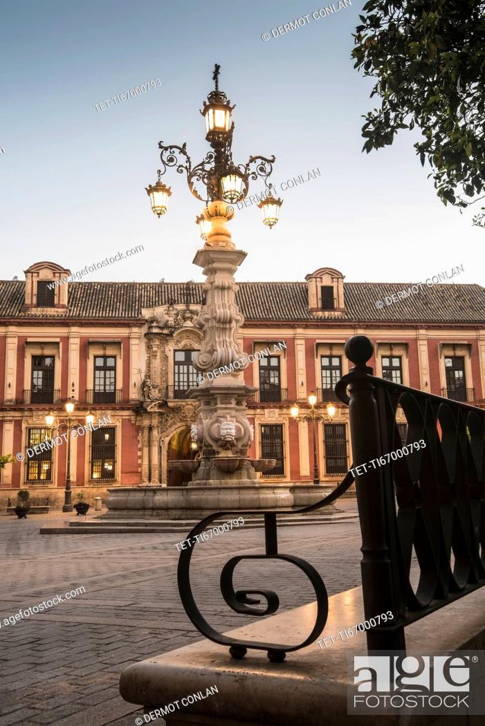 Stock Photo: Spain, Seville, Plaza Virgin De Los Reyes, Town square at dusk.