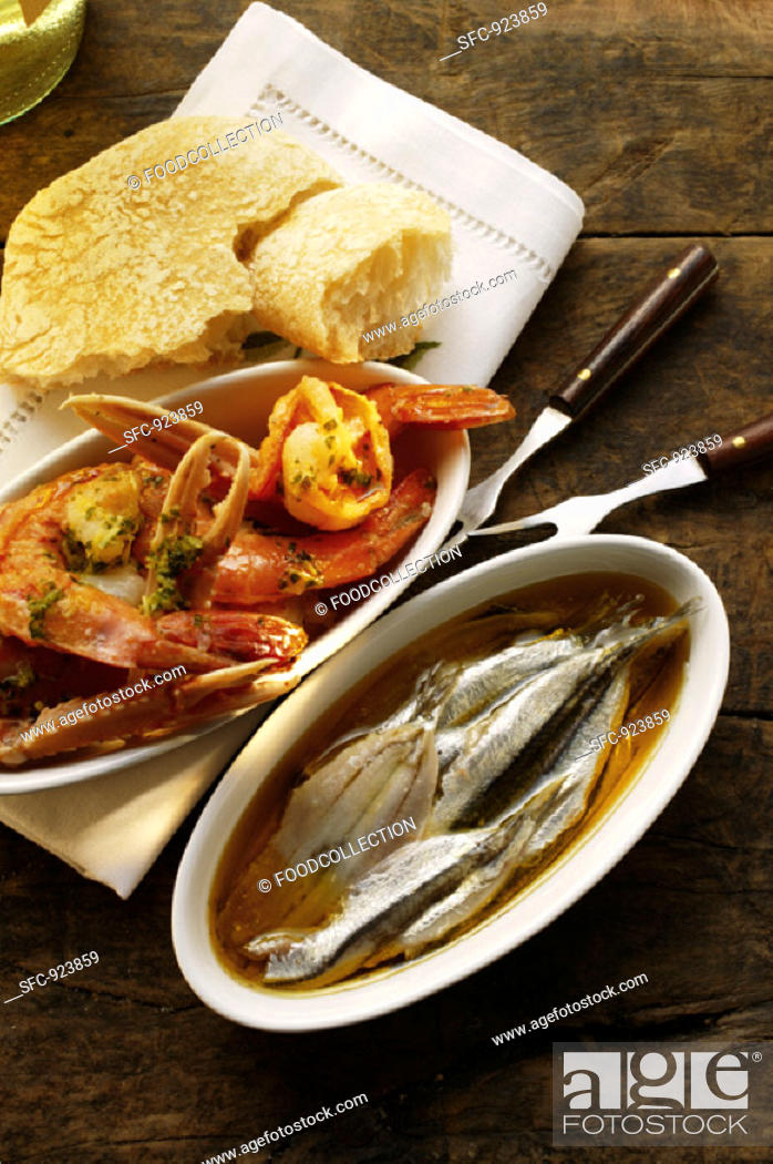 Stock Photo: Pickled sardines and fried scampi.