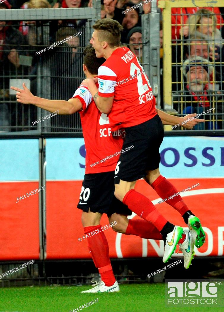 Stock Photo: Freiburg's Marc-Oliver Kempf celebrates the 2-0 goal with Maximilian Philipp (R) during the German Bundesliga soccer match between SC Freiburg and Hannover 96.
