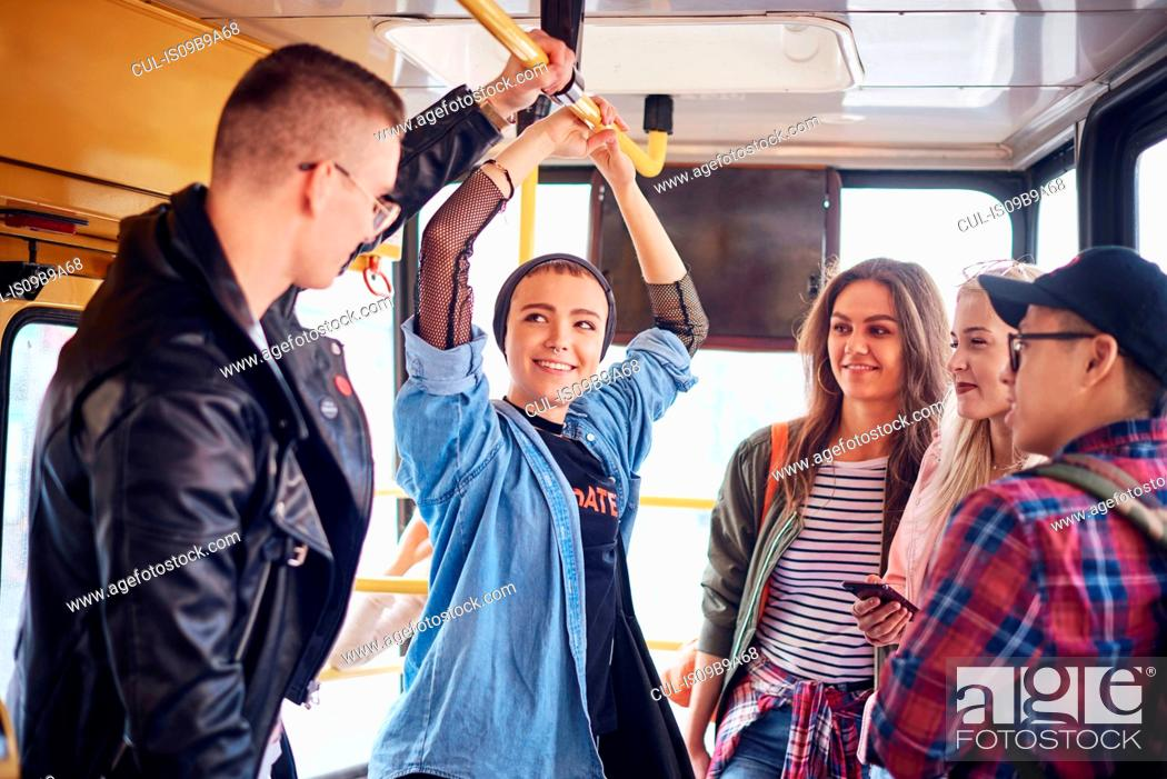 Stock Photo: Five young adult friends chatting on city tram.