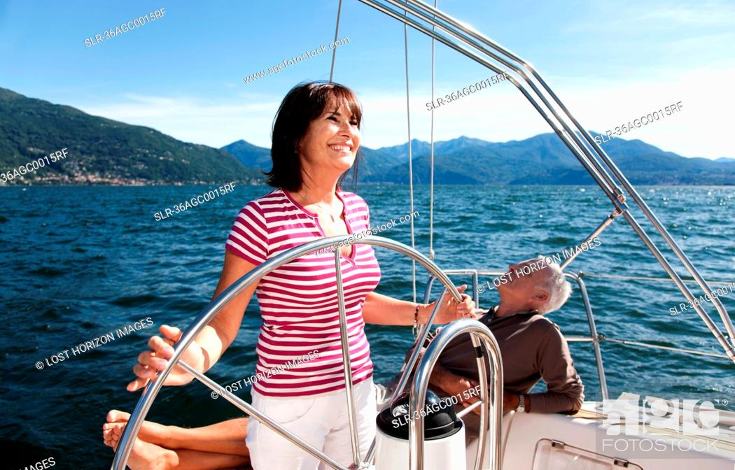 Stock Photo: Older couple relaxing on sailboat.