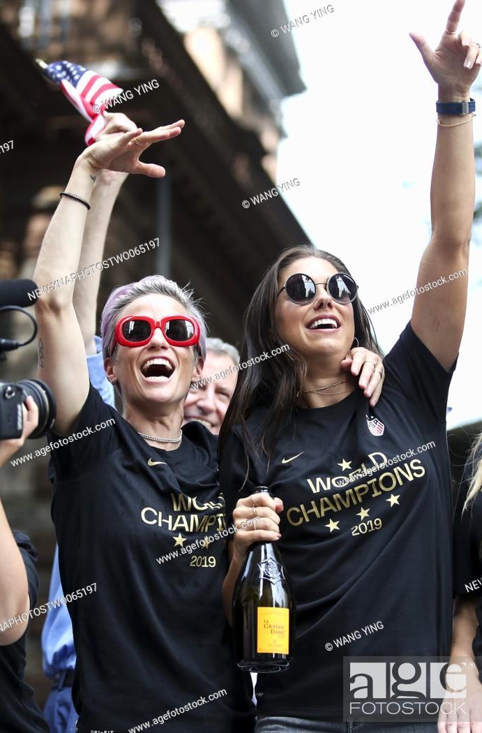 Stock Photo: (190711) -- NEW YORK, July 11, 2019 (Xinhua) -- U.S. women's soccer team members Megan Rapinoe (L) and Alex Morgan celebrate during the ticker-tape parade for.