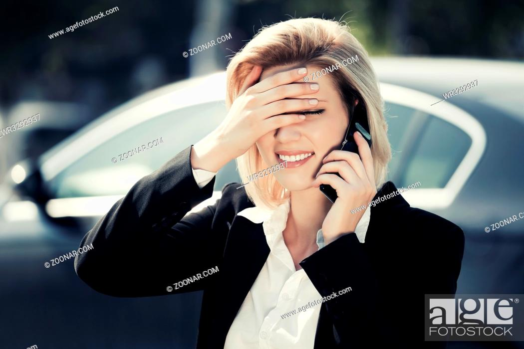 Stock Photo: Young business woman calling on the cell phone.