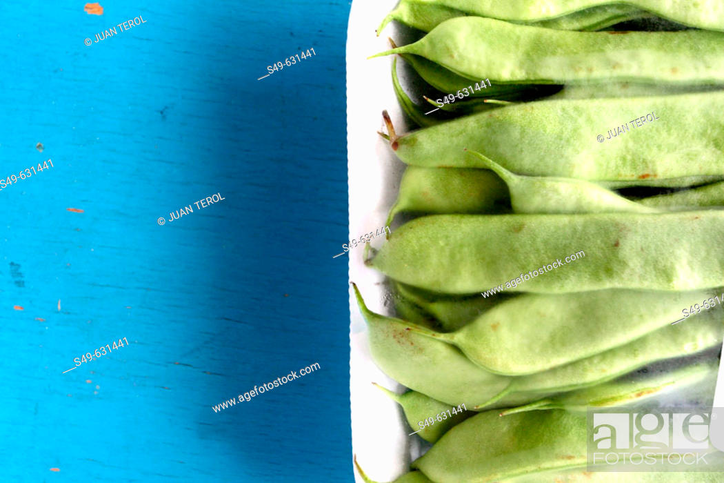 Stock Photo: Green beans on wooden blue table.