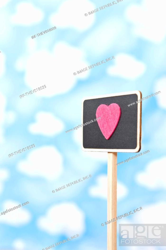 Stock Photo: wallpaper and heart shape on sign.