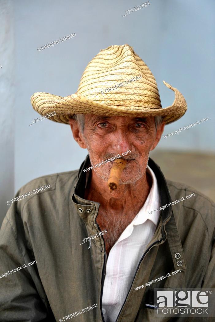 e5e08cc50 Portrait of Cuban man smoking cigar in Trinidad,Cuba, Stock Photo ...