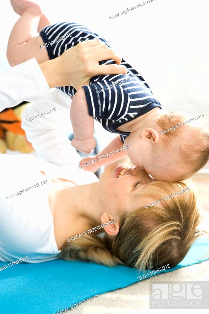 Stock Photo: mama playing with baby.