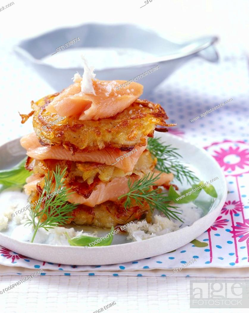 Stock Photo: Potato and onion rosti with salmon trout and horseradish.