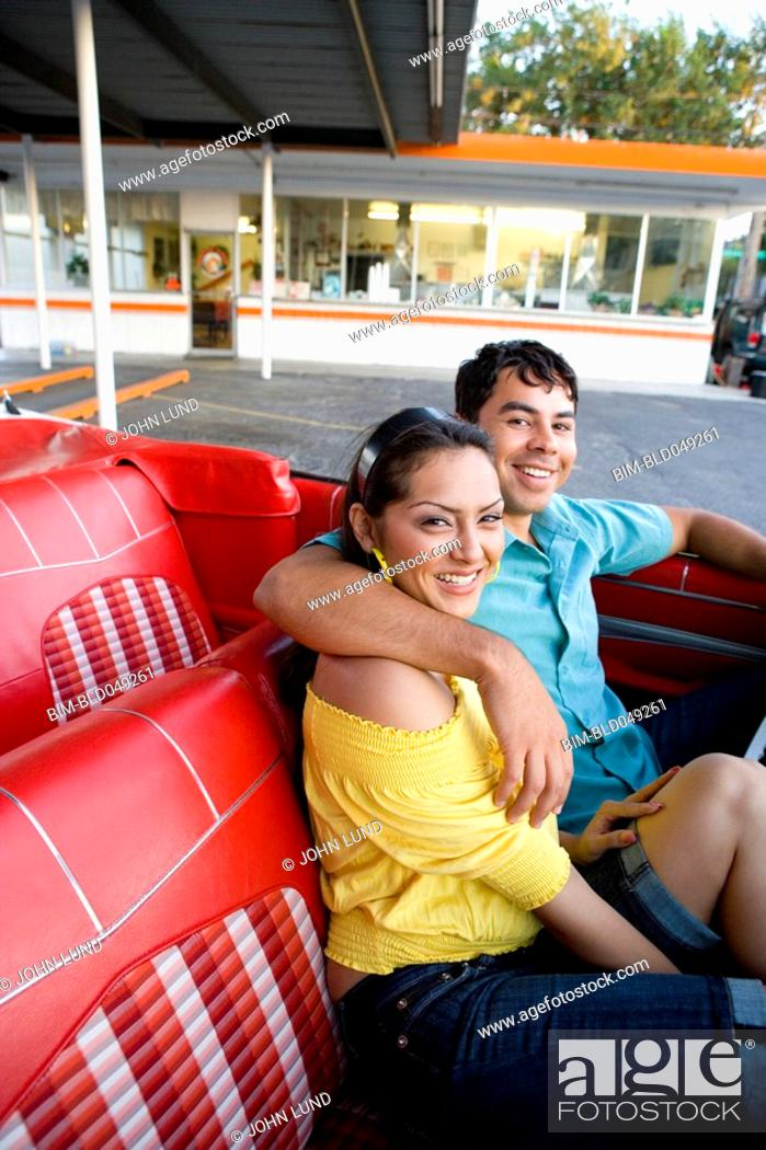 Stock Photo: Hispanic couple sitting in convertible.