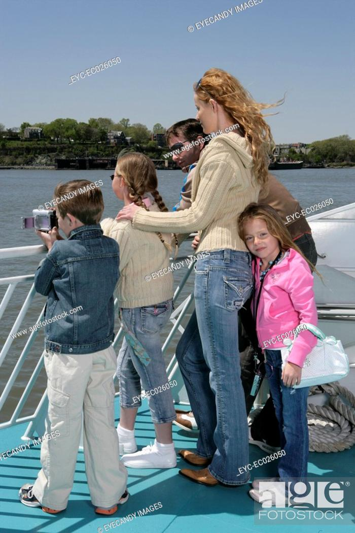 Stock Photo: Family sightseeing on a ferryboat.