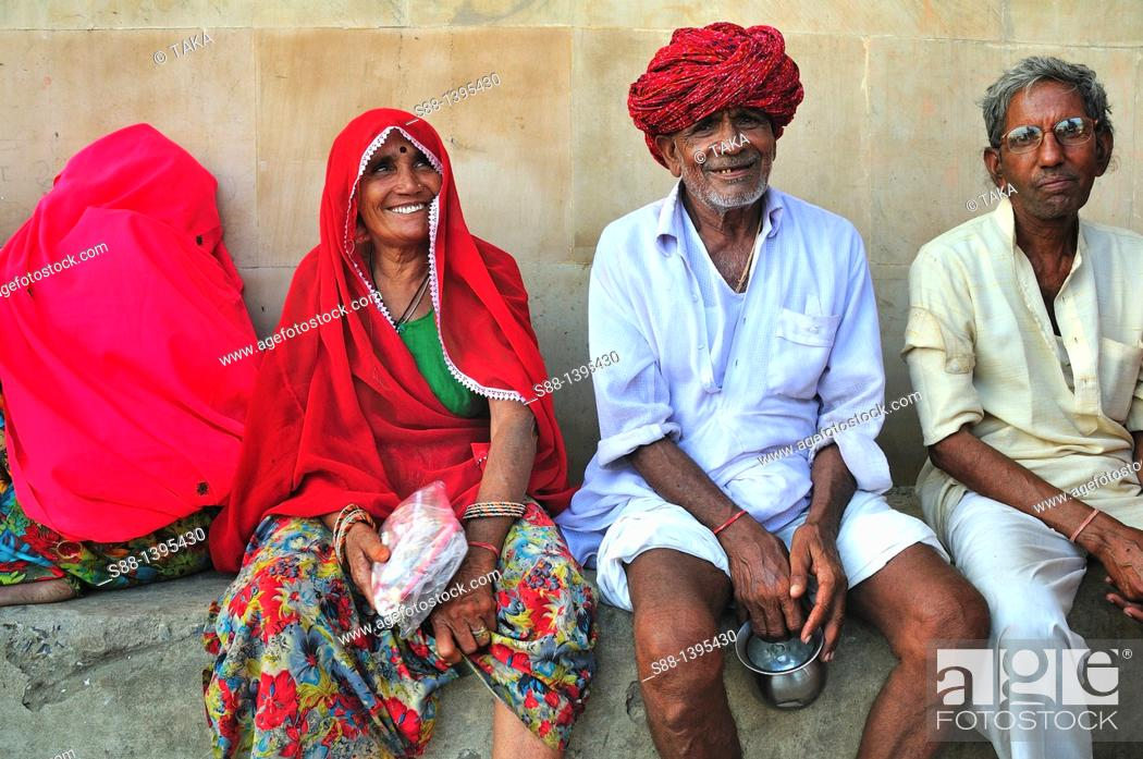 Stock Photo: Pilgrims at the ghat by the Ganges river.