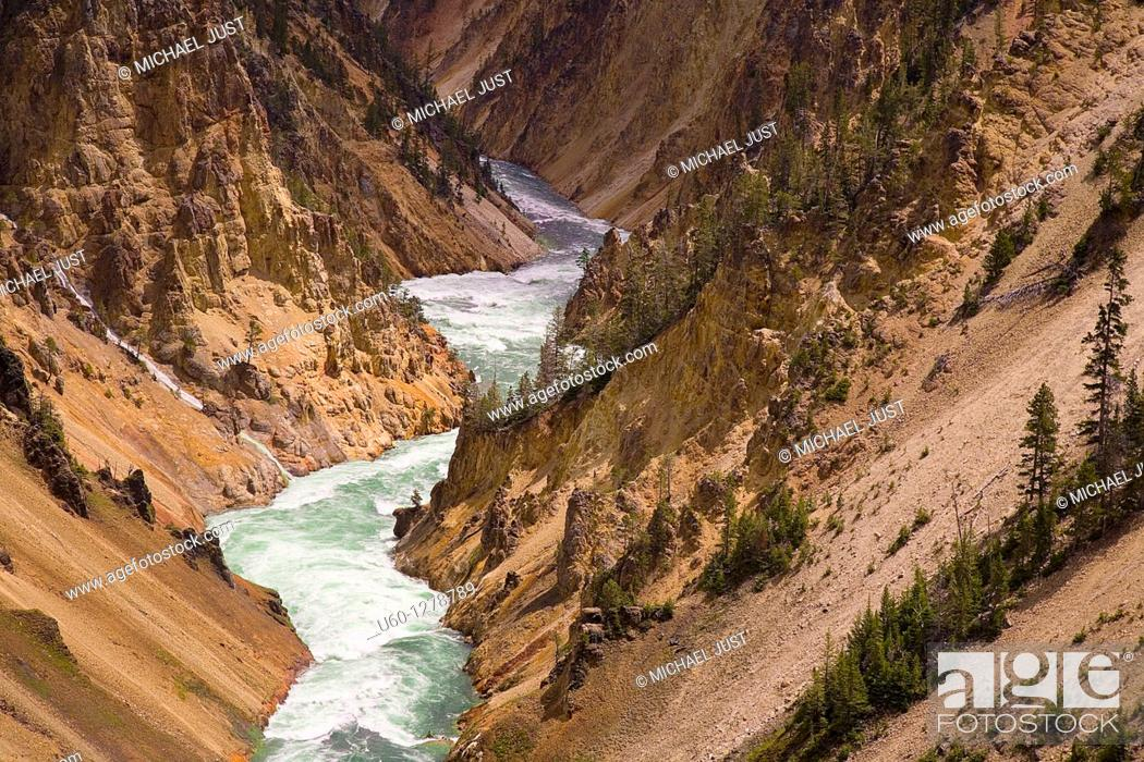Stock Photo: The Yellowstone River carves its way through the Grand Canyon of the Yellowstone at Yellowstone National park, Wyoming.