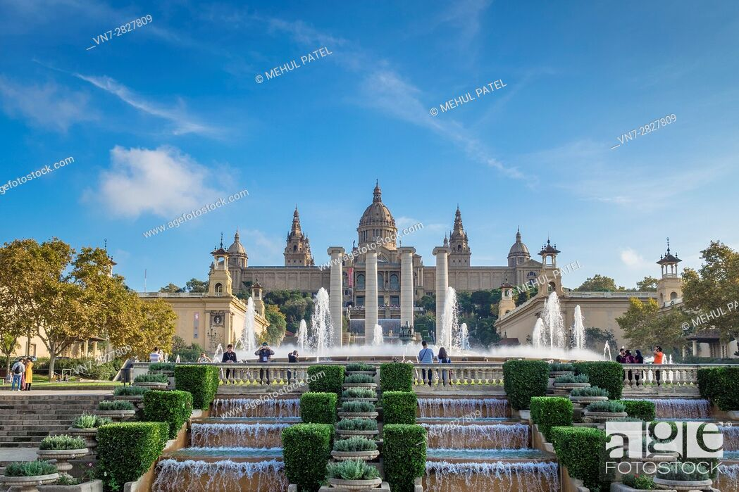 Stock Photo: The Magic Fountain of Montjuic and the Palau Nacional which houses the Museu Nacional d'Art de Catalunya (MNAC), Barcelona - Catalonia, Spain.