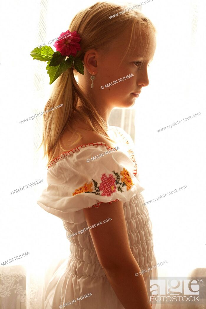 Stock Photo: Young girl with flower in her hair.