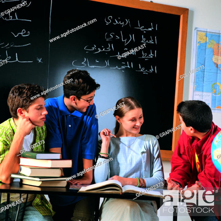 Stock Photo: Group of pupils in classroom.