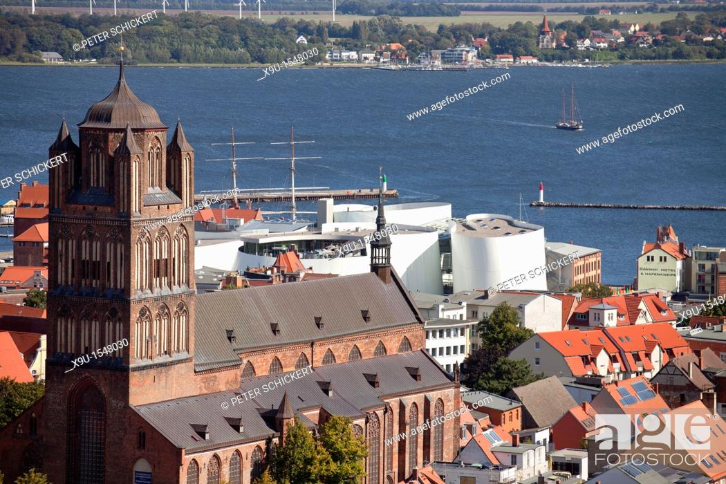 Stock Photo: view over the historic centre of Stralsund with Saint James's Church, Ozeaneum and Ruegen island, Hanseatic City of Stralsund, Mecklenburg-Vorpommern, Germany.
